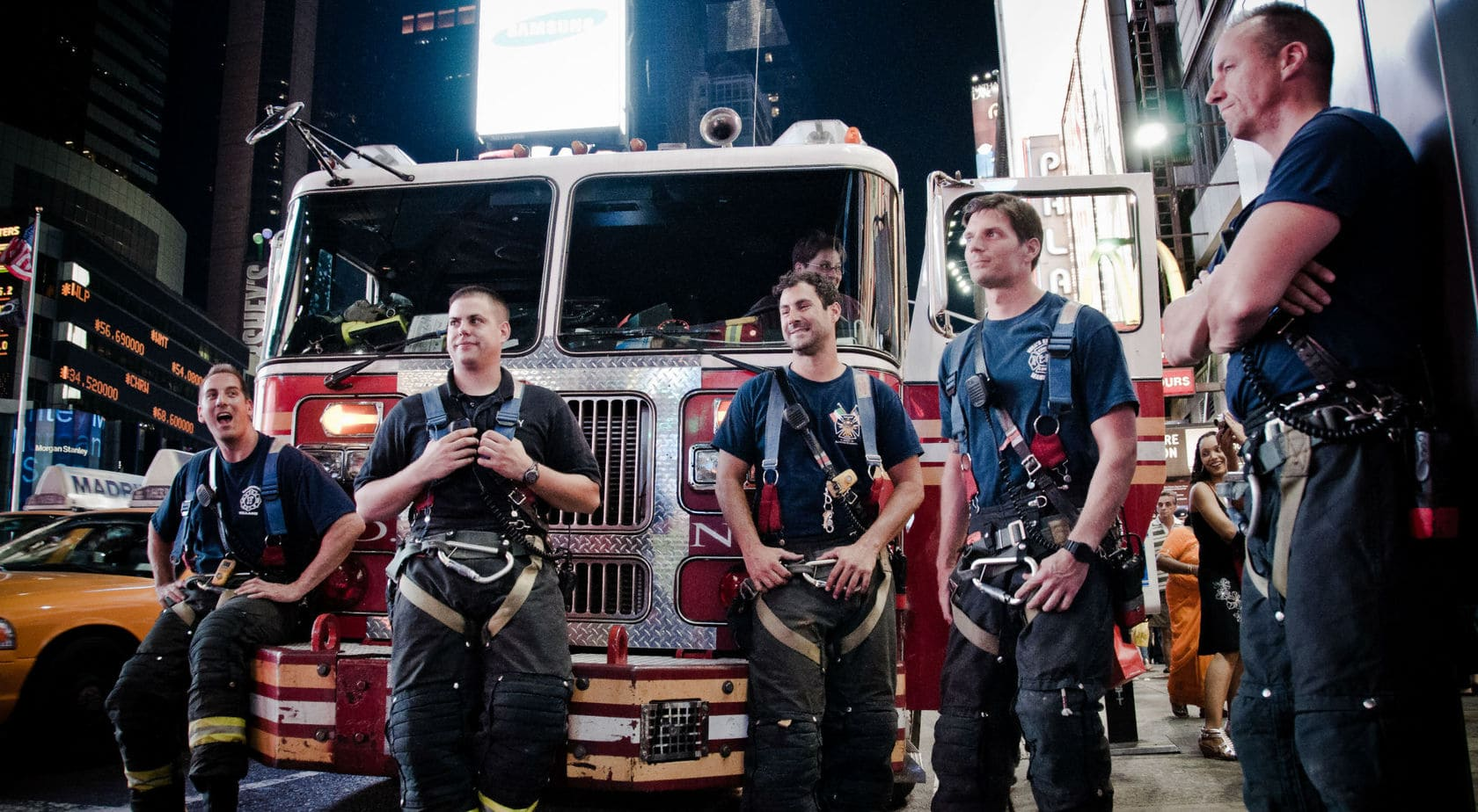 New York City firemen rest after they put out a fire.